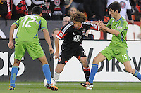 D.C. United midfielder Nick DeLeon (18) shields the ball against Seattle Sounders midfielder Alvaro Fernandez (15) right and in front of him  defender Leo Gonzalez (12)  D.C. United tied the Seattle Sounders, 0-0 at RFK Stadium, Saturday April 7, 2012.