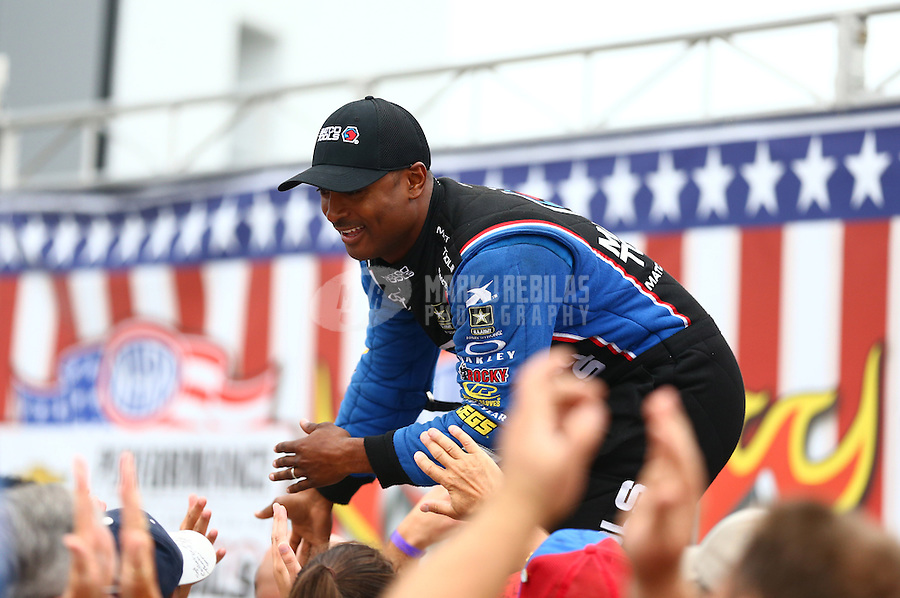 Sept. 2, 2013; Clermont, IN, USA: NHRA top fuel dragster driver Antron Brown during the US Nationals at Lucas Oil Raceway. Mandatory Credit: Mark J. Rebilas-