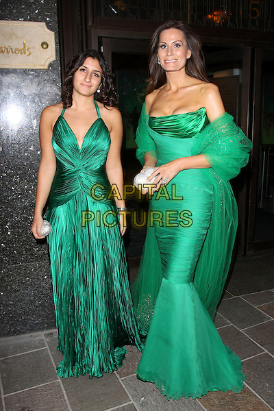 GUEST & ISABELLA CHRISTENSSEN.Leaving the Emerald Ball in aid of The Elton John AIDS Foundation, Harrods, London, England. .November 5th, 2009 .full length green Christensen Kristensen dress silk satin chiffon sheer sash wrap fishtail ruched silver clutch bag silk satin strapless halterneck .CAP/AH.©Adam Houghton/Capital Pictures.