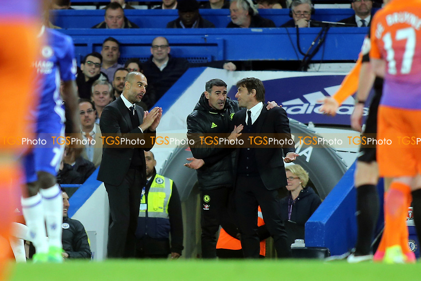 Manchester City Manager, Pep Guardiola and Chelsea Manager, Antonio Conte exchange words during Chelsea vs Manchester City, Premier League Football at Stamford Bridge on 5th April 2017