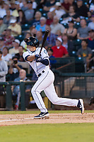 AFL West first baseman Evan White (15), of the Peoria Javelinas and Seattle Mariners organization, follows through on his swing during the Arizona Fall League Fall Stars game at Surprise Stadium on November 3, 2018 in Surprise, Arizona. The AFL West defeated the AFL East 7-6 . (Zachary Lucy/Four Seam Images)