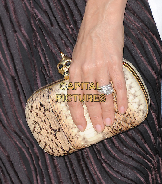 Salma Hayek's hand.The L.A. Premiere of 'Puss in Boots' held at The Regency Village  Theatre in Westwood, California, USA..October 23rd, 2011 .hand print gold clutch bag diamond ring snakeskin beige black brown  .CAP/RKE/DVS.©DVS/RockinExposures/Capital Pictures.