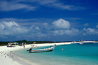 Well-to-do Venezuelans relaxing on a Caribbean beach, Los Roques islands, Venezuela