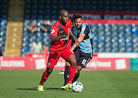 Anthony Straker of York City and Sam Wood of Wycombe Wanderers in action during the Sky Bet League 2 match between Wycombe Wanderers and York City at Adams Park, High Wycombe, England on 8 August 2015. Photo by Andy Rowland.