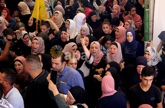 Relatives of Palestinian Naseem Al-Roumi, 14, was shot dead by Israeli forces for allegedly attempting to carry out a stabbing attack on August and Israeli army kept his body withheld since that, mourn during his funeral in the West Bank village of Al-Eizariya, near east of Jerusalem, on September 21, 2019. Photo by Mosab Shawer