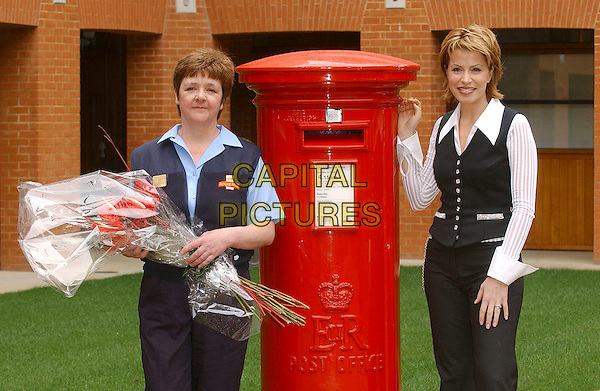 HELEN MACKENZIE & NATASHA KAPLINSKI.Presents Helen Mackenzie with the Royal Mail Postwomen of the Year In The Company's 1st Class People Awards. Helen saved a man's life after he severed his arm in a factory machine, London, UK..March 27th, 2006.Ref: BEL.half length black vest white shirt post bouquet flowers.www.capitalpictures.com.sales@capitalpictures.com.© Capital Pictures.