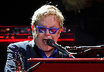 Elton John performs at the Bonnaroo Music and Arts Festival on Sunday, June 15, 2014, in Manchester, Tenn. (Photo by Wade Payne/Invision/AP)