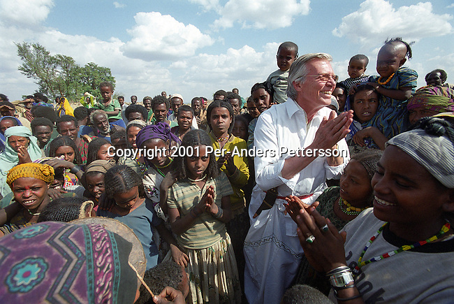 HARAR, ETHIOPIA FEBRUARY 7: Austrian actor KarlHeinz Bohm meets villagers as he visits an opening of a water project for several villages in a rural area February 7, 2001 outside Harar, Ethiopia. He Bohm has a house and runs his aid organization 'Menschen for Menschen in the area. Mr. Bohm runs several projects around the country and he is a popular man in the country. (Photo by Per-Anders Pettersson/Getty Images)