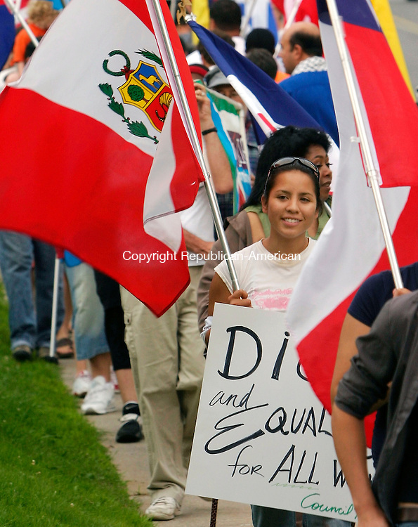 WATERTOWN, CT - 12 JULY 2005 -071205JS09--Leslie Prado with Latinos Contra La Guerra of Hartford, was one of the many protesters at the immigration meeting at the American Legion hall in Watertown. The meeting was organized by the CT Citizens for Immigration Control.   --Jim Shannon Photo--Leslie Prado,  Latinos Contra La Guerra are CQ