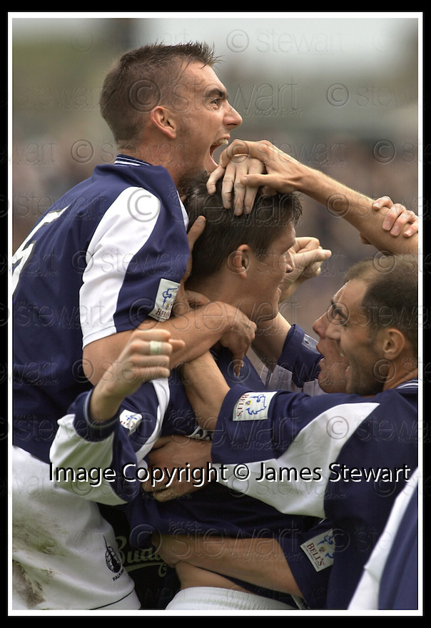 28/9/02       Copyright Pic : James Stewart                     .File Name : stewart-falkirk v st j'stone 21.KEVIN JAMES (CENTRE) IS CONGRATULATED BY STEVEN RENNIE (TOP) AND JAMIE MCQUILKEN AFTER SCORING THE LATE WINNER.....James Stewart Photo Agency, 19 Carronlea Drive, Falkirk. FK2 8DN      Vat Reg No. 607 6932 25.Office : +44 (0)1324 570906     .Mobile : + 44 (0)7721 416997.Fax     :  +44 (0)1324 570906.E-mail : jim@jspa.co.uk.If you require further information then contact Jim Stewart on any of the numbers above.........