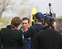 Jockey Jason Watson is interviewed by Lydia Hislop during Racing at Newbury Racecourse on 12th April 2019