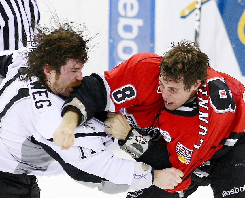 San Antonio Rampage's Ryan Hollweg, left, fights with Abbotsford Heat's Cam Cunning during the second period of an AHL hockey game, Wednesday, March 2, 2011, in San Antonio. (Darren Abate/pressphotointl.com)