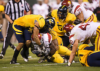 October 13th, 2011:  California defense brings down USC's running back during a game at AT&T Park in San Francisco, Ca  -  USC defeated California 30 - 9