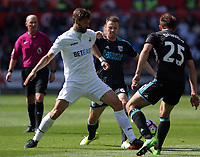 (L-R) Fernando Llorente of Swansea City is challenged by Jonny Evans and Craig Dawson of West Bromwich Albion during the Premier League match between Swansea City and West Bromwich Albion at The Liberty Stadium, Swansea, Wales, UK. Sunday 21 May 2017