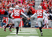 Ohio State Buckeyes place kicker Sean Nuernberger (96) and Ohio State Buckeyes punter Cameron Johnston (95) celebrate after a touchdown in the second quarter by Ohio State Buckeyes wide receiver Devin Smith (9) at Ohio Stadium in Columbus, Saturday, September 13, 2014. (Dispatch Photo by Jenna Watson)