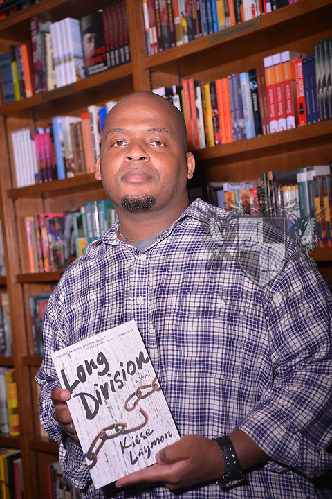 CORAL GABLES, FL - JULY 11: Author Kiese Laymon signs copies of his book 'Long Division' at Books and Books on July 11, 2013 in Coral Gables, Florida. (Photo by Johnny Louis/jlnphotography.com)
