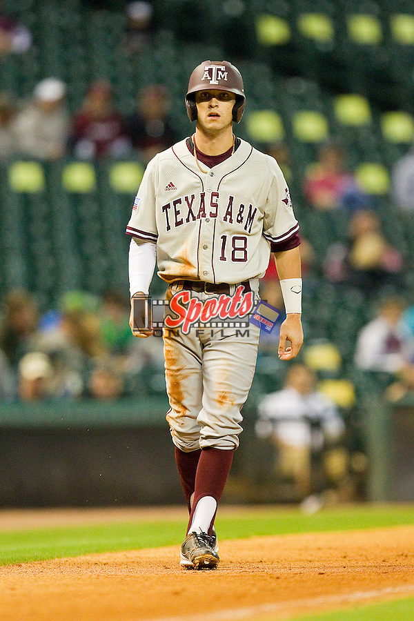Tyler Naquin #18 of the Texas A&M Aggies takes his lead off of third base against the Houston Cougars at Minute Maid Park on March 6, 2011 in Houston, Texas.  Photo by Brian Westerholt / Four Seam Images