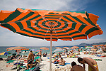 Italy; Elba, Portoferraio, Porto Ferraio, Porto Argo, Beach umbrella, Town beach, Province of Livorno; Mediterranean Sea; Tyrrhenian Sea; Tuscan archipelago, Europe,.