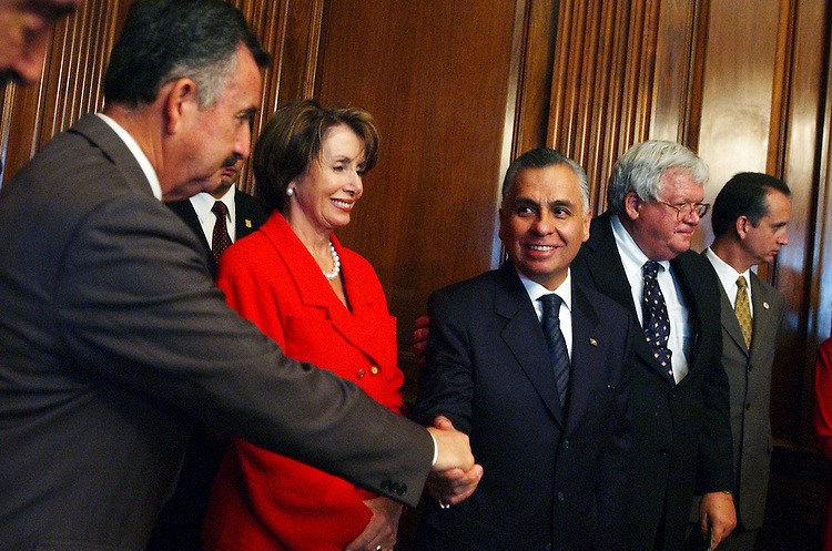 Rep. Ciro Rodriguez, D-Texas, left, shakes hands with Rafael Macedo de la Concha, Attorney General of Mexico, during a Cinco de Mayo luncheon.  House Minority Leader Nancy Pelosi, D-Calif., Speaker Dennis Hastert, R-Ill., and Rep. Mario Diaz-Balart, R-Fla., far right, are also pictured.