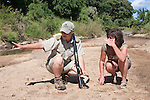 Gudied bush walk on safari, ranger showing spoor to Ann Toon, Makalali game reserve, South Africa