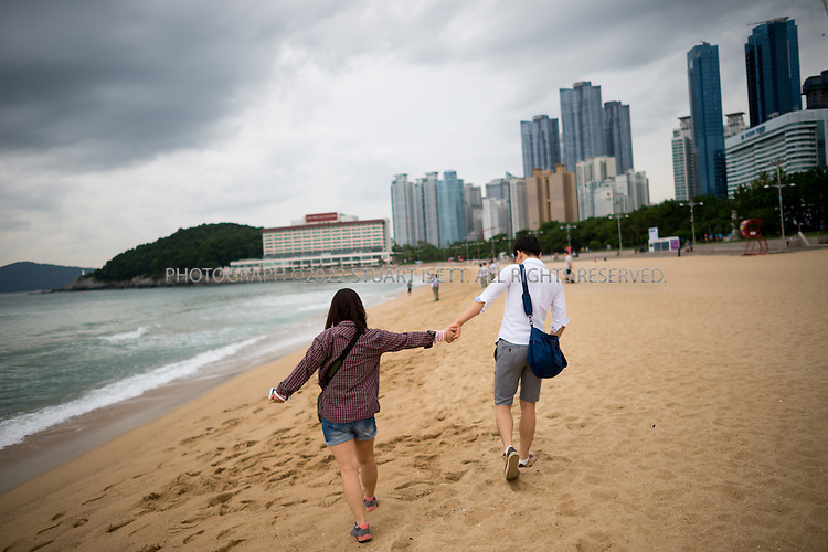 9/3/2013--Busan, South Korea<br /> <br /> Young lovers along Haeundae Beach in Busan (Pusan).<br /> <br /> Photograph by Stuart Isett<br /> &copy;2013 Stuart Isett. All rights reserved.