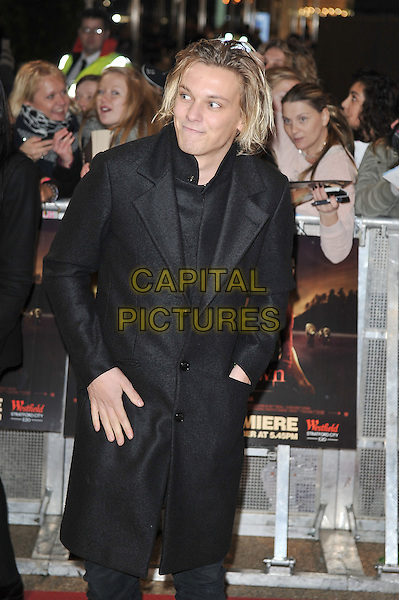 Jamie Campbell Bower.'The Twilight Saga: Breaking Dawn - Part 1' UK film premiere at Westfield Stratford City, London, England..16th November 2011.half length black coat hand in pocket .CAP/MAR.© Martin Harris/Capital Pictures.