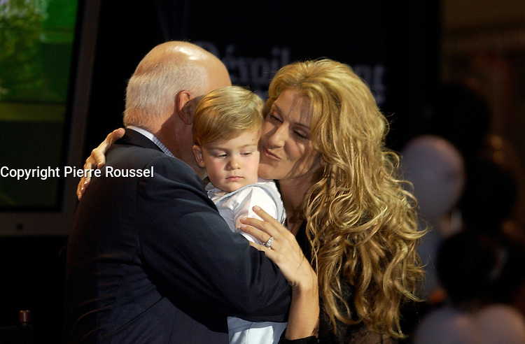 September 26. 2002, Montreal, Quebec, Canada; <br /> <br /> Celine Dion (R) her husband Rene Angelil (L) and their baby boy Rene-Charles,  unveil her Bronze Star at the Pepsi Forum's Walk of Fame, September 26 2002, Montreal, CANADA.