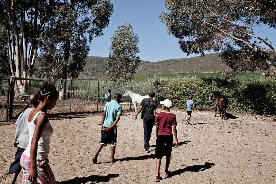 CAPE TOWN, SOUTH AFRICA JANUARY 2011:<br />Equine assisted therapy at De Grendel farm Cape Town, through the Montrose clinic and foundation.The clinic treats patients with addiction illnesses such as alcoholism and eating disorders and the foundation is a charity that helps with street children from the townships.<br /> Elkana Childcare Safe house, adrop-in centre and a shelter for children on the street. The centre is based in Malmesbury, Western Cape and is for children who have been through emotional, physical and sexual misuse.<br /> @ GDS