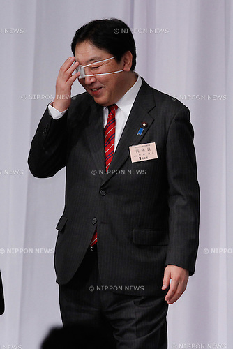 January 16, 2012, Tokyo, Japan - With a white patch over his right eye, Japans Prime Minister Yoshihiko Noda is about to addresses members of the ruling Democratic Party of Japan, calling on them to unite behind controversial tax and social security reforms during a DPJ convention at a Tokyo hotel on Monday, January 16, 2012. Noda said Japan had no future if the necessary measures werent undertaken. Noda is staking his career on pushing ahead with a plan to double the sales tax by 2015, but his call has created a deep rift within the DPJ, resulting in nine lawmakers bolting in protest. Noda has reportedly bumped his face in the darkness at his official residence in the previous night. (Photo by AFLO) UUK -mis-