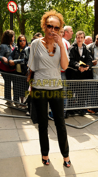 KIM APPLEBY.The Ivor Novello Awards, Grosvenor House, Park Lane, London, England..May 22nd, 2008.full length black trousers grey gray top sunglasses shades hand funny face finger scratching.CAP/CAN.©Can Nguyen/Capital Pictures.