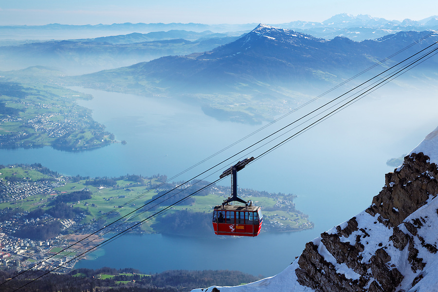 Gondola lift hanging from cables high above Lake Lucerne, near summit of Mount Pilatus, Switzerland
