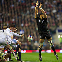 Victor Vito of New Zealand attempts to block the box kick of Ben Youngs of England during the QBE Autumn International match between England and New Zealand at Twickenham on Saturday 01 December 2012 (Photo by Rob Munro)