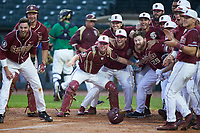 The Florida State Seminoles wait to celebrate a home run with Jackson Lueck (not pictured) against the Notre Dame Fighting Irish in Game Four of the 2017 ACC Baseball Championship at Louisville Slugger Field on May 24, 2017 in Louisville, Kentucky. The Seminoles walked-off the Fighting Irish 5-3 in 12 innings. (Brian Westerholt/Four Seam Images)