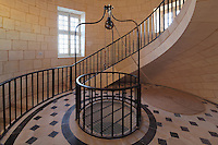 Salle du Contrepoids, with pulley, patterned marble floor and spiral staircase, built by Joseph Teulere in the 18th century, at the Phare de Cordouan or Cordouan Lighthouse, built 1584-1611 in Renaissance style by Louis de Foix, 1530-1604, French architect, located 7km at sea, near the mouth of the Gironde estuary, Aquitaine, France. This is the oldest lighthouse in France. There are 4 storeys, with keeper apartments and an entrance hall, King's apartments, chapel, secondary lantern and the lantern at the top at 68m. Parabolic lamps and lenses were added in the 18th and 19th centuries. The lighthouse is listed as a historic monument. Picture by Manuel Cohen