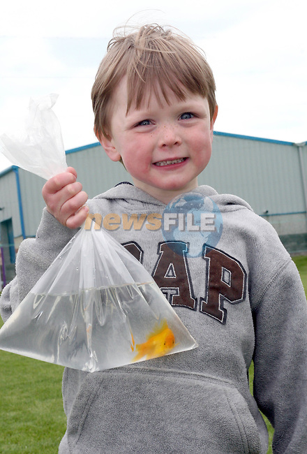 Ben Kelly and Toby the goldfish at the Newtown Blues Sports Day....Photo NEWSFILE/Jenny Matthews.(Photo credit should read Jenny Matthews/NEWSFILE)....This Picture has been sent you under the condtions enclosed by:.Newsfile Ltd..The Studio,.Millmount Abbey,.Drogheda,.Co Meath..Ireland..Tel: +353(0)41-9871240.Fax: +353(0)41-9871260.GSM: +353(0)86-2500958.email: pictures@newsfile.ie.www.newsfile.ie.FTP: 193.120.102.198.