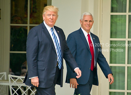 United States President Donald J. Trump and US Vice President Mike Pence arrive for a ceremony where the President will sign a Proclamation designating May 4, 2017 as a National Day of Prayer and an Executive Order &quot;Promoting Free Speech and Religious Liberty&quot; in the Rose Garden of the White House in Washington, DC on Thursday, May 4, 2017.<br /> Credit: Ron Sachs / CNP