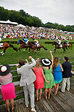 USA, Tennessee, Nashville, Iroquois Steeplechase, spectators watch and cheer on horses during the first race of the day