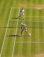 England, London, Juli 06, 2015, Tennis, Wimbledon, Andy Murray (GBR) hits a passing shot along Ivo Karlovic (CRO)<br /> Photo: Tennisimages/Henk Koster