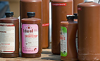 A bottle of photo darkroom chemicals was among the bottles and cans of leftover household chemicals and cleaners dropped off at a hazardous waste disposal site in Westerville, Ohio. Homeowners were able to remove any hazardous waste from their homes to be properly recycled or disposed of instead of placing in their trash or pouring down the drain.<br />