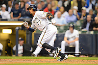 Milwaukee Brewers outfielder Carlos Gomez #27 during a game against the Los Angeles Dodgers at Miller Park on May 22, 2013 in Milwaukee, Wisconsin.  Los Angeles defeated Milwaukee 9-2.  (Mike Janes/Four Seam Images)