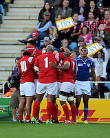 Telusa Veainu of Tonga is congratulated after scoring a try during Match 20 of the Rugby World Cup 2015 between Tonga and Namibia - 29/09/2015 - Sandy Park, Exeter<br /> Mandatory Credit: Rob Munro/Stewart Communications