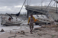 Palm Beach, Riviera Beach, Fl. 9/5/04-- FRANCES 06-- Chuck Riley  looks for his belongings where his boat was demolished and washed ashore during Hurricane Frances at Phil Foster Park on Riviera Beach in Palm Beach County after Hurricane Frances pounded the Florida East coast. PHOTOS 34 OF  IMAGES STAFF MS contest