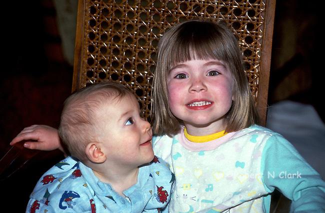 Boy looking up at big sister