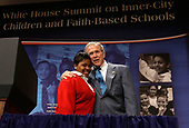 United States President George W. Bush (R) hugs Aysia Mayo-Gray, a student of St. Ann's Academy in Washington, DC, prior to his address to the White House Summit on Inner-City Children and Faith-Based Schools at Ronald Reagan Building and International Trade Center April 24, 2008 in Washington, DC. Bush, who was introduced by Mayo-Gray, spoke to educators, clergy, philanthropists and business leaders on helping faith-based schools from closures. According to the National Center for Education Statistics, about 1,200 urban faith-based schools have closed their doors between 2000 and 2006 and that affected more than 400,000 students.  <br /> Credit: Alex Wong / Pool via CNP