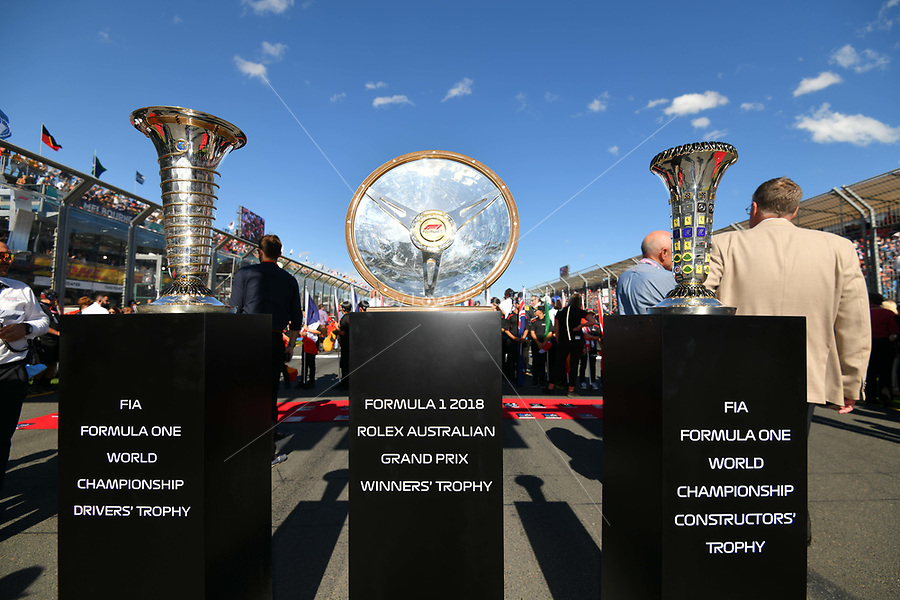 March 25, 2018: The race trophies are displayed on the grid prior to the start of the 2018 Australian Formula One Grand Prix at Albert Park, Melbourne, Australia. Photo Sydney Low