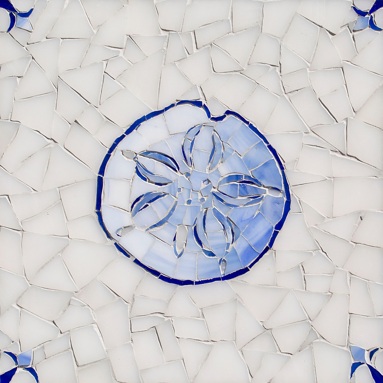 Sand Dollar Delft, a hand-cut cut jewel glass mosaic, shown in  Opal Sea Glass™ with jewel glass Lapis Lazuli, Iolite, and Covelite, is part of the Sea Glass™ Collection by New Ravenna.