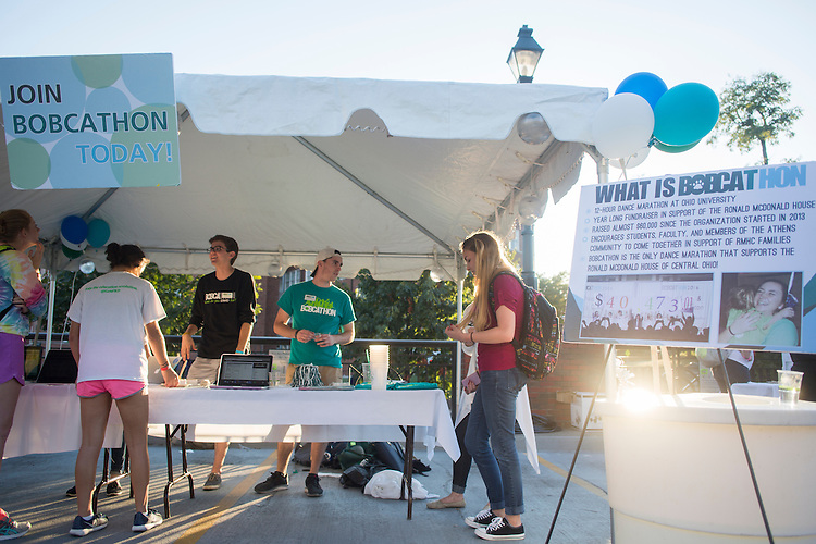 Members of BobcaThon talk to others about signing up to be part of the organization during BobcaThon's cake walk on October 5, 2016.