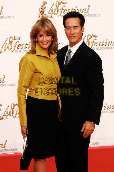 DEIDRE HALL & DRAKE HOGESTYN .Arrivals at the 48th Monte Carlo Television Festival on June 8, 2008 in Monaco, Monte Carlo. .June 8th, 2008.half length black suit jacket blue tie yellow blouse shirt skirt .CAP/TTL.© TTL/Capital Pictures