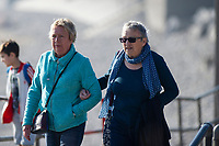 WEATHER PICTURE WALES<br /> Two ladies have a stroll during the unusually warm weather in Langland Bay near Swansea, Wales, UK. Wednesday 27 February 2019