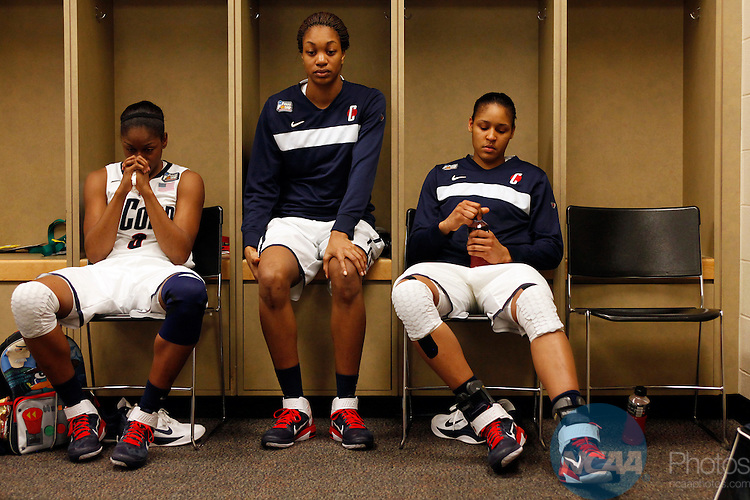 03 APR 2011:  Tiffany Hayes (3), Michala Johnson (25) and Maya Moore (23) of the University of Connecticut react to the Huskies loss against Notre Dame University during the Division I Women's Basketball Semifinals held at Conseco Fieldhouse in Indianapolis, IN.  Notre Dame defeated Connecticut 72-63 to advance to the national title game.  Jamie Schwaberow/NCAA Photos